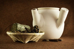 Herbs and chinese clay pot Stock Image