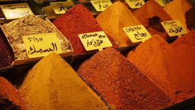 Many piles of spices in turkish traditional souk market