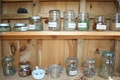 Herbs dried in jars on shelves Royalty Free Stock Photography