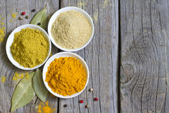 Herbs and dried spices on wooden board Stock Image