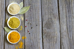 Herbs and dried spices on wooden board Stock Photos