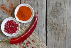 Herbs and dried spices on wooden board Royalty Free Stock Photos