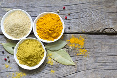 Herbs and dried spices on wooden board Royalty Free Stock Photography
