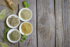 Herbs and dried spices on wooden board Stock Photography