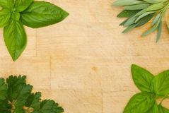 Herbs framing wooden board Royalty Free Stock Images