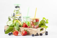Herbs and fruits flavored infused water with strawberries and mint. Summer refreshing drink. Health care, fitness, healthy nutriti Stock Photo