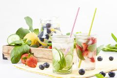 Herbs and fruits flavored infused water with strawberries and mint. Summer refreshing drink. Health care, fitness, healthy nutriti Royalty Free Stock Photo