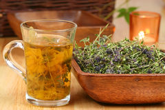 Herbs in glass and bowl Royalty Free Stock Photography