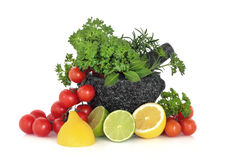 Herbs Leaves, Fruit and Tomatoes Stock Photos
