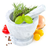 Herbs in mortar Royalty Free Stock Photo