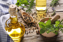 Herbs and oil Royalty Free Stock Images