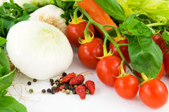 Herbs, onion, garlic, basil, peppers and tomato Royalty Free Stock Photography