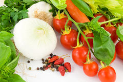 Herbs, onion, garlic, basil, peppers and tomato Royalty Free Stock Photos