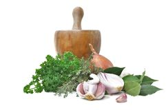 Herbs,onions,garlic and pestle Royalty Free Stock Photos