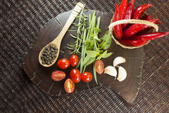 Herbs and peppers Stock Image