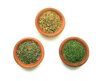 Herbs in Pinch Bowls. Basil, Oregano, and Parsley in wooden pinch bowls on white background Stock Photo