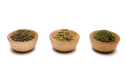 Herbs in Pinch Bowls. Wooden pinch bowls on white background containing (left to right): Basil, Oregano, and Parsley Royalty Free Stock Images