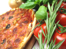 Herbs and pizza. Picture of some herbs and vegetables you might use on your pizza Stock Images