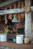 Herbs in pots on porch rail. Herbs in pots on a rustic wooden porch rail in Vico Equense, Italy stock image