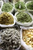 Herbs on sale in Qatari souq. Sacks of dried herbs on sale in Souq Waqif, Qatar, Arabia. The leaves are used in traditional infusions and cookery Royalty Free Stock Images