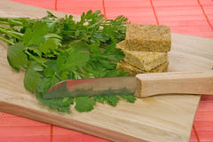 Herbs for soup. Lovage and chervil with boullin cubes  for soup Stock Image