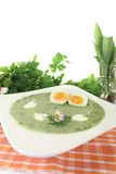 Herbs soup with eggs and a dollop of cream Royalty Free Stock Photo