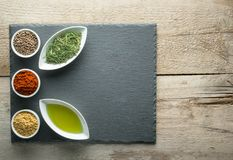 Herbs and Spice on slate tray on an old rustic table. Free space for your text Stock Photo
