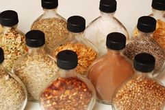 Herbs and Spices. Glass bottles of assorted herbs and spices royalty free stock photos