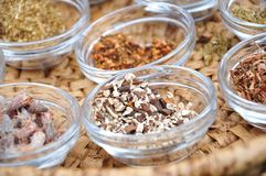 Herbs and spices. Variety of natural herbs and spices in glass bowls stock photo