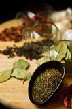 Herbs and spices. On a wooden table royalty free stock images