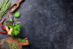 Herbs and spices. Cooking on stone table. Basil, rosemary, pepper and salt. Top view with copyspace royalty free stock photography