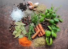 Herbs and spices on a kitchen table Stock Images