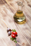 Herbs spices and olive oil on a new burned wooden background Royalty Free Stock Images