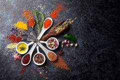 Herbs and spices. Over black stone background. Top view with copy space stock photo