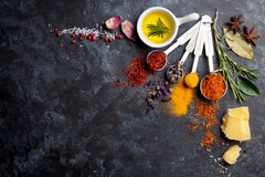 Herbs and spices. Over black stone background. Top view with copy space stock image
