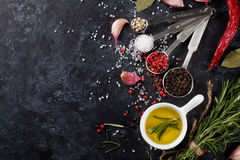 Herbs and spices over black stone Royalty Free Stock Image