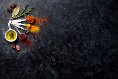 Herbs and spices over black stone royalty free stock photography