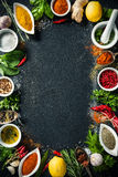 Herbs and spices over black stone background royalty free stock photography