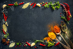 Herbs and spices over black stone background. Top view with copy space Royalty Free Stock Image