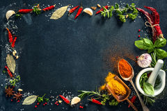 Herbs and spices over black stone background Stock Photography