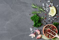 Herbs and spices over black stone background. Top view with copy space. Stock Photos