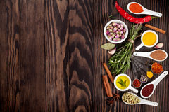 Herbs and spices over wood background Stock Photos
