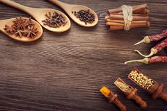 Herbs and Spices over wooden background.  Royalty Free Stock Image