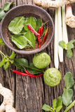 Herbs and Spices over wooden background Stock Photos