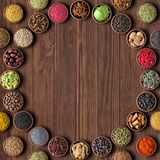 Herbs and spices over wooden table background. multicolored seas Stock Photography