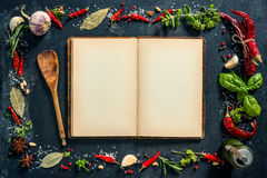 Herbs and spices with a recipe book Royalty Free Stock Images