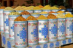 Herbs and spices in round barrels on display in front of a shop in Marrakech in Morocco, Africa royalty free stock photography