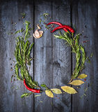 Herbs and spices round frame on blue wooden background, top view stock images