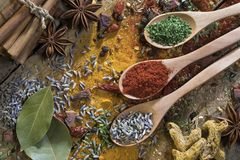 Herbs and Spices on a rustic farmhouse table Stock Photo