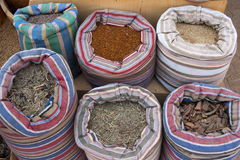 Herbs and spices section on an Egyptian Market. Herb and spices in colorful coton bags on an Egyptian market Royalty Free Stock Image